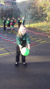 Outdoor P.E, learning ball skills.